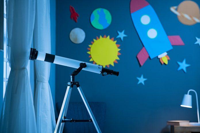 Telescope in astronomic child's bedroom