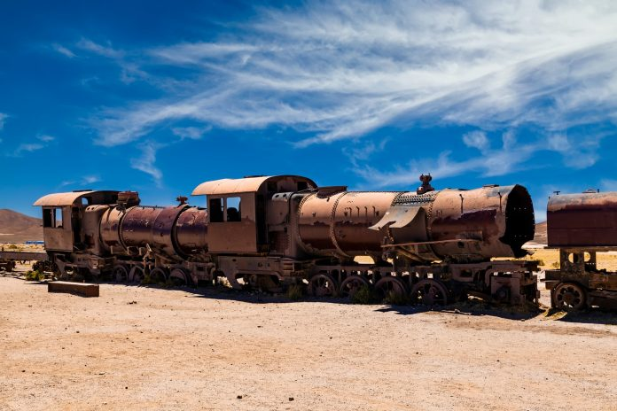 Old rusty locomotive abandoned in the train cemetery of Uyuni, Bolivia